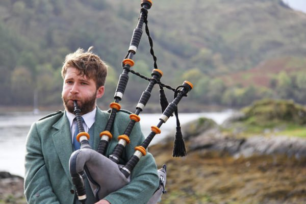 Man playing bag pipes
